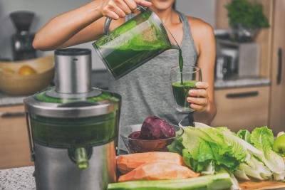 bigstock woman juicing making green jui